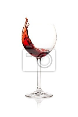 Wall mural Splashing red wine in a glass