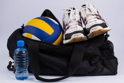 Wall mural Sports bag with sportswear and ball.