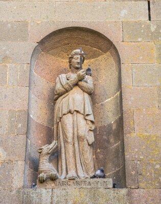 Statue of catholic saint Margarita adorns entrance to medieval temple