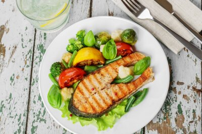 Wall mural steak grilled salmon with vegetables on a plate