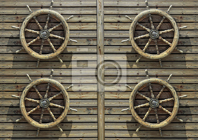 Steering wheels of the ship on a wooden wall