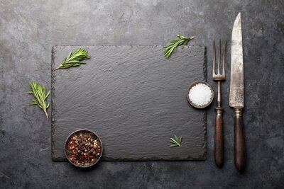 Wall mural Stone board with spices and utensils