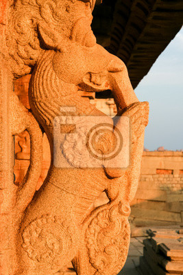Stone carving on pillar in hampi