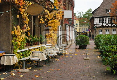 Street cafe in the autumn in a European city