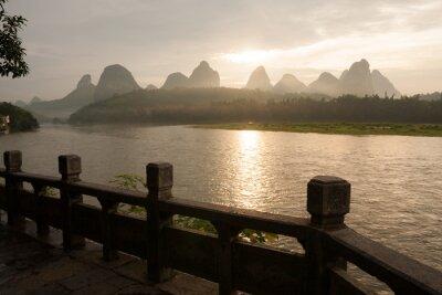 Sunrise over karst mountain and river Li in Yangshuo China landscape