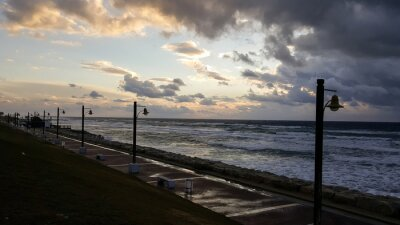 Sunset, on promenade of Mediterranean Sea, winter, Haifa, Israel