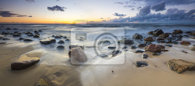 Wall mural sunset over the sea beach