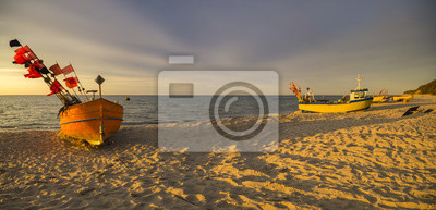 Wall mural sunset over the sea beach,Fishing boats on the sand