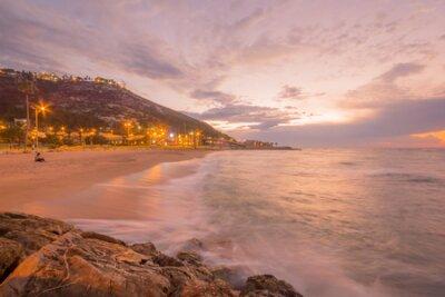 Sunset view of the Bat-Galim beach and the Carmel mountain, in Haifa, Israel