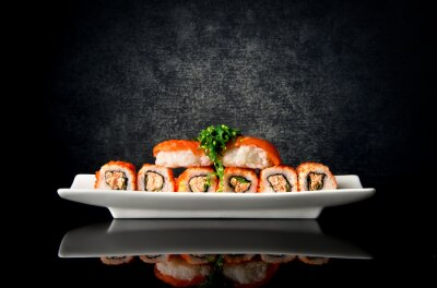 Wall mural Sushi and rolls in plate