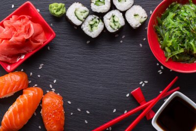 Wall mural sushi and rolls on a slate table