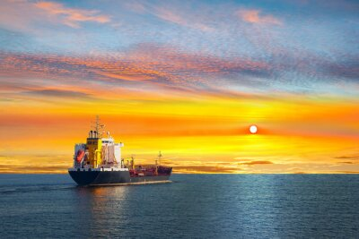 Wall mural Tanker ship on calm sea in the morning.