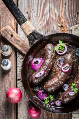Wall mural Tasty black pudding with parsley and onion