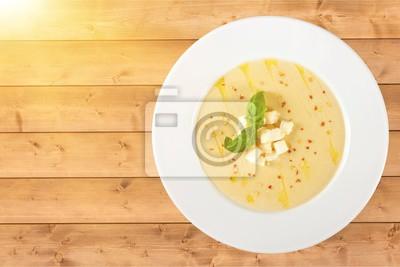 Tasty Squash Soup on background