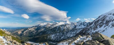 Wall mural Tatra mountains witch beautiful clouds