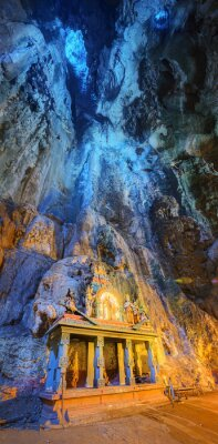 Wall mural Temple in the middle of a cavern at Batu Caves Temple complex in Kuala Lumpur
