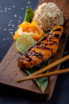 Wall mural Teriyaki salmon with rice on a wooden platter