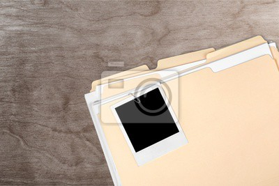 The blank photo on a business folder on wooden table