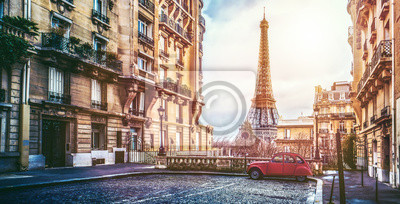 Wall mural The eifel tower in Paris from a tiny street
