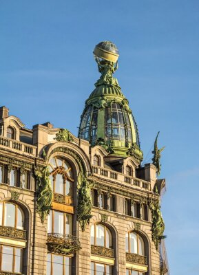 The facade of old building decorated with beautiful sculptures and  glass dome