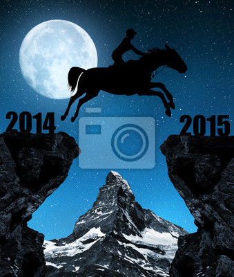 The rider on the horse jumping into the New Year 2015.