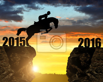 The rider on the horse jumping into the New Year 2016