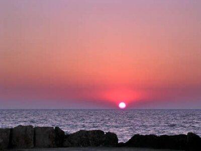 The sunset over the Mediterranean sea in Haifa, Israel, June 25, 2003