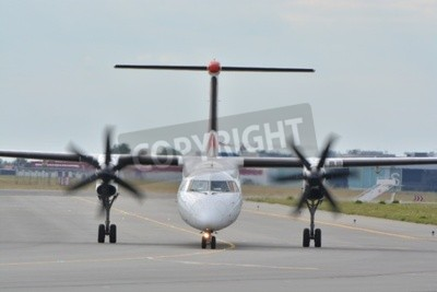Wall mural This is a view of Eurolot plane Bombardier Dash-8 Q400 registered as SP-EQC on the Warsaw Chopin Airport. July 30, 2015. Warsaw, Poland.