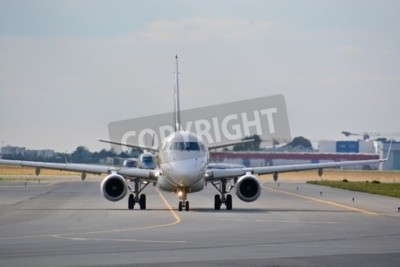Wall mural This is a view of LOT Polish Airlines Embraer ERJ 170 plane registered as SP-LDE on the Warsaw Chopin Airport. July 30, 2015. Warsaw, Poland.