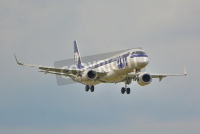Wall mural This is a view of LOT Polish Airlines Embraer ERJ 195 plane registered as SP-LNA on the Warsaw Chopin Airport. September 16, 2015.