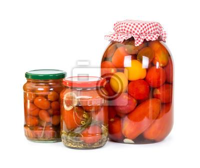 Three jars of pickled tomatoes