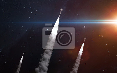 Three rockets in space. Elements of this image furnished by NASA