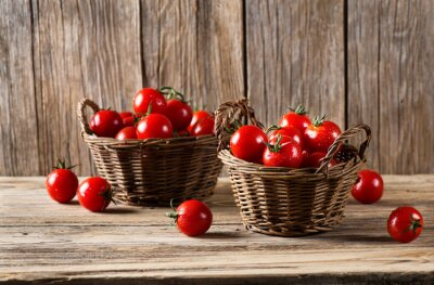Wall mural Tomatoes in a baskets