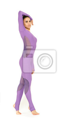 Wall mural Toned body. Beautiful fit and toned gymnast woman posing gracefully isolated on white