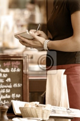 Toned outdoor cafe scene with waitress taking order