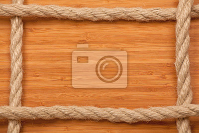 Wall mural Toned photo. Color tone tuned. frame made of rope on wooden board