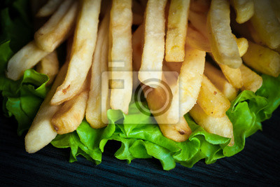 Wall mural Toned photo. Color tone tuned. French fries on wooden background