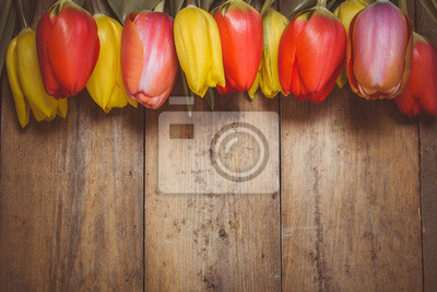 Wall mural Toned photo. Color tone tuned. Fresh red tulip flowers bouquet on wood. Natural spring or Valentine's Day, Mother's Day theme.