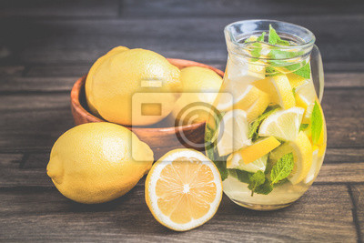 Wall mural Toned photo. Color tone tuned. Jar of frozen homemade lemonade with mint on wooden background