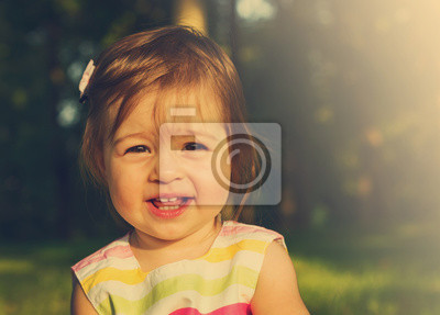 Wall mural Toned portrait of happy cute smiling girl . Toned