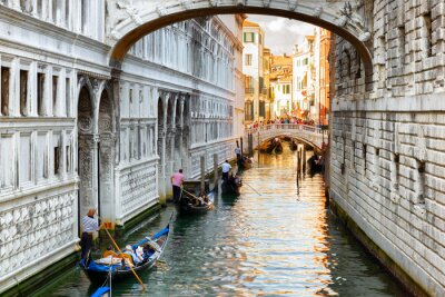 Wall mural Tourists in gondolas sailing under the Bridge of Sighs in Venice