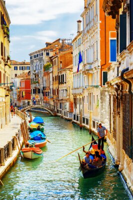 Wall mural Tourists traveling in gondola, Rio Marin Canal, Venice, Italy