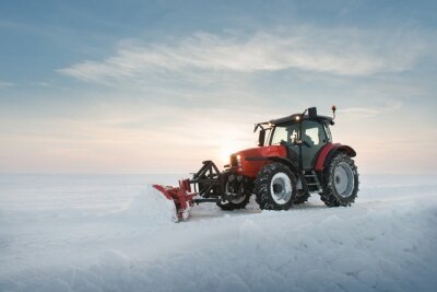 Wall mural Tractor cleaning snow
