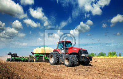 Wall mural tractor in a field
