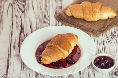 Wall mural traditional croissants with jam for breakfast