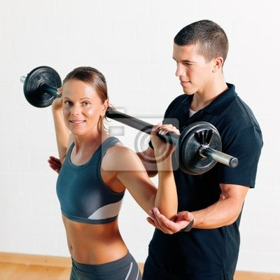 Trainer and woman in the gym