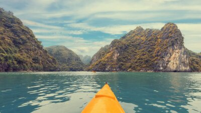 Wall mural Trip on colourful kayak