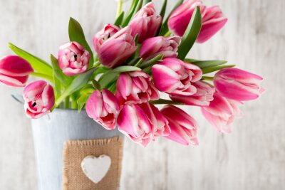 Wall mural Tulips on the grey  background.