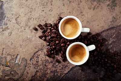 Wall mural Two cups of coffee with coffee beans on a stone background