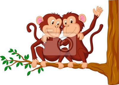 Two monkeys sitting on a tree